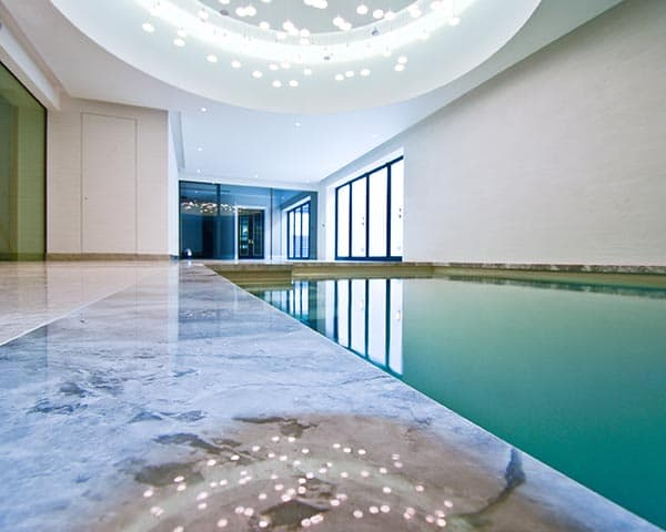Heated glass for pools